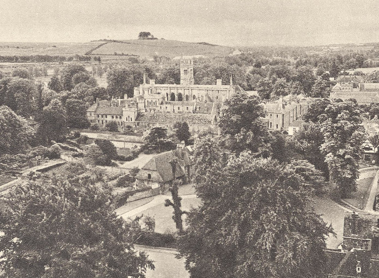 A photograph of the college, among the trees of Winchester